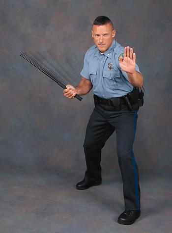 cop_with_baton.jpeg