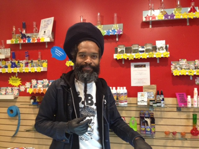 Budtender Jason McDaniel behind the counter at Sticky Medz in Los Angeles.