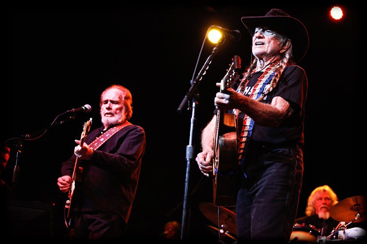 Merle Haggard and Willie Nelson on stage together in 2015.