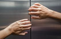 elevator.hands.getty