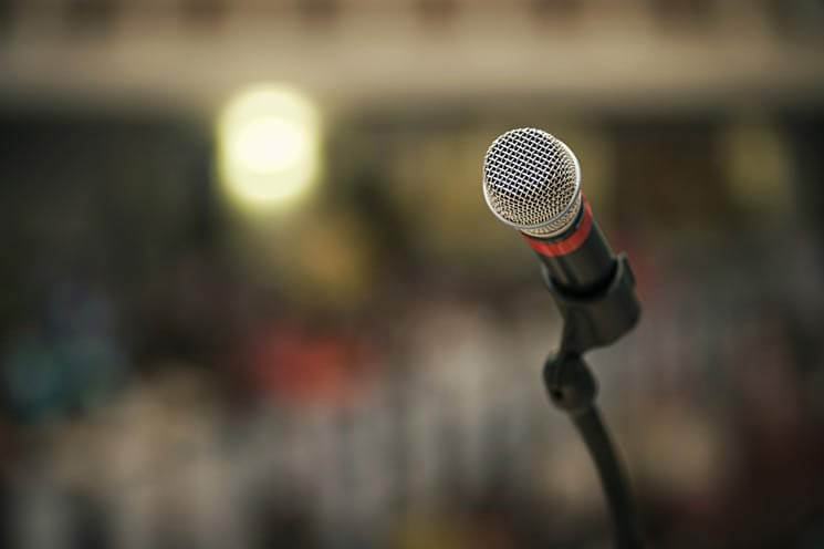 microphone_on_stand_in_front_of_blurry_background